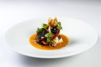 bacalao suquet de gambas-calamares y pulpo kitchen club